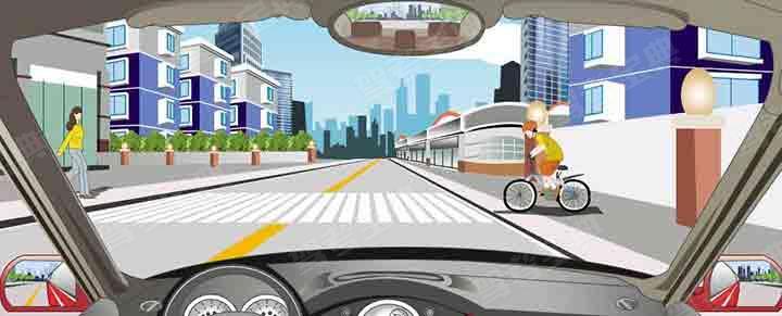 如图所示,接近人行横道线时怎样安全行驶?